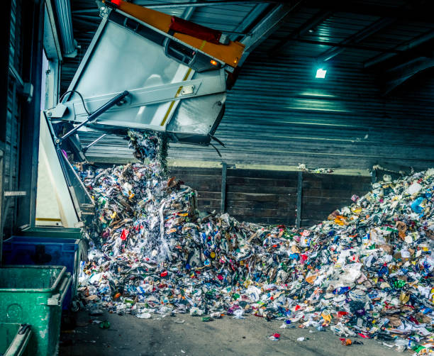 Tipping recycling into storage shed stock photo