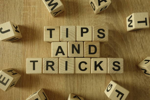 Tips and tricks text Tips and tricks text from wooden blocks on desk magic trick stock pictures, royalty-free photos & images