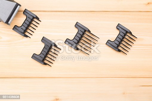 1147090180istockphoto tips on wooden background for electromachine hair 931408608