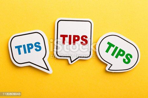 istock Tips Speech Bubble Isolated On Yellow Background 1130809043