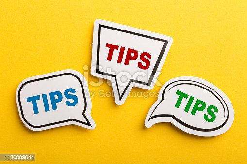istock Tips Speech Bubble Isolated On Yellow Background 1130809044