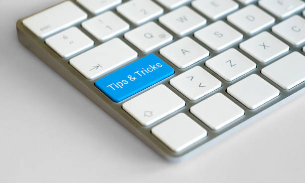 Tips & Tricks Icon Concept on the Blue Keyboard Button Guide, Working, Turkey - Middle East, Advice, Tip magic trick stock pictures, royalty-free photos & images