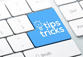 istock Tips & Tricks Icon Concept on the Blue Keyboard Button 1268712056