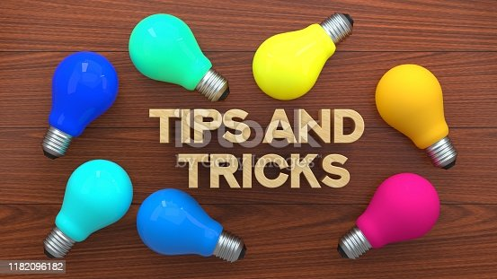 istock Tips & Tricks Light Bulb Concept, Colorful Light Bulb On Wooden Background 1182096182