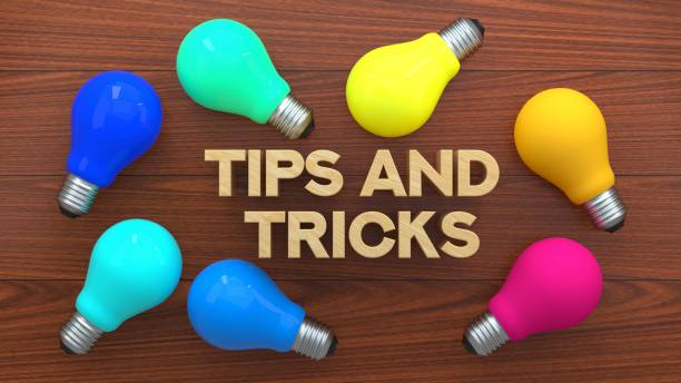 Tips & Tricks Light Bulb Concept, Colorful Light Bulb On Wooden Background Tips & Tricks Light Bulb Concept, Colorful Light Bulb On Wooden Background magic trick stock pictures, royalty-free photos & images