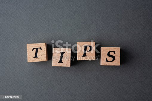 tips word written in wooden cubes.