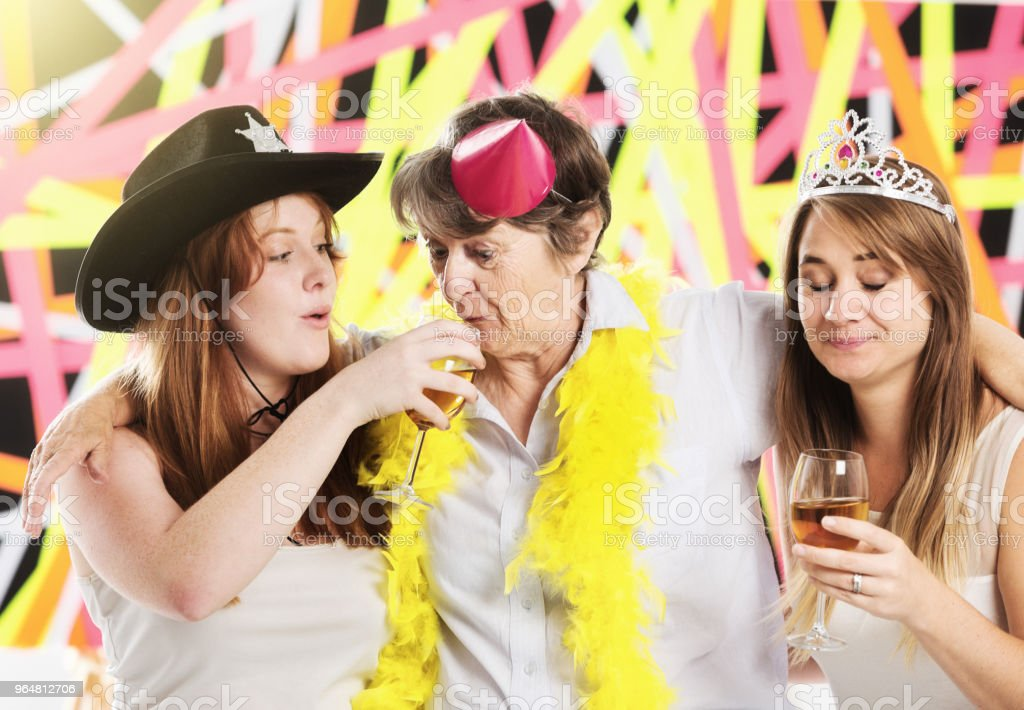 Tipsy multi-generation women messing about at a party royalty-free stock photo