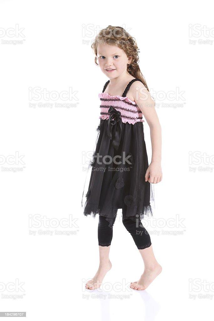 Tiptoeing Little Girl stock photo