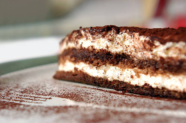 tiramissu Delicious  tiramisu cake and fork trace in a plate tiramisu stock pictures, royalty-free photos & images