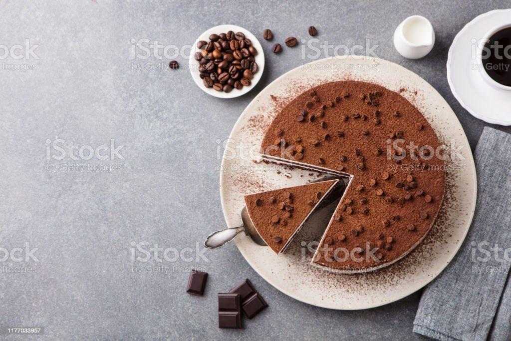 Tiramisu cake with chocolate decoration on a plate. Grey stone background. Top view. Copy space. - Royalty-free Bebida Alcoólica Foto de stock