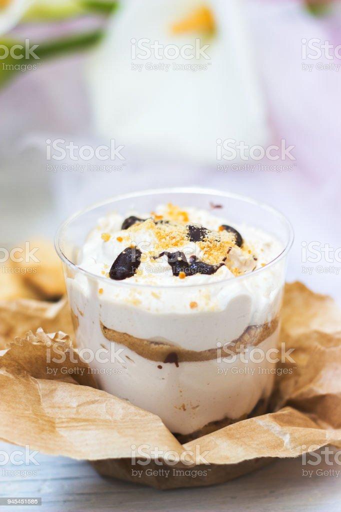 Tiramisu dessert in transparent plastic cup