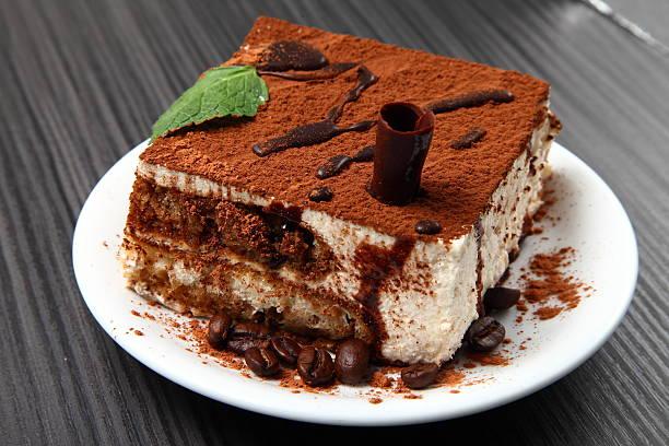 tiramisu dessert on a porcelain plate - tiramisu fotografías e imágenes de stock