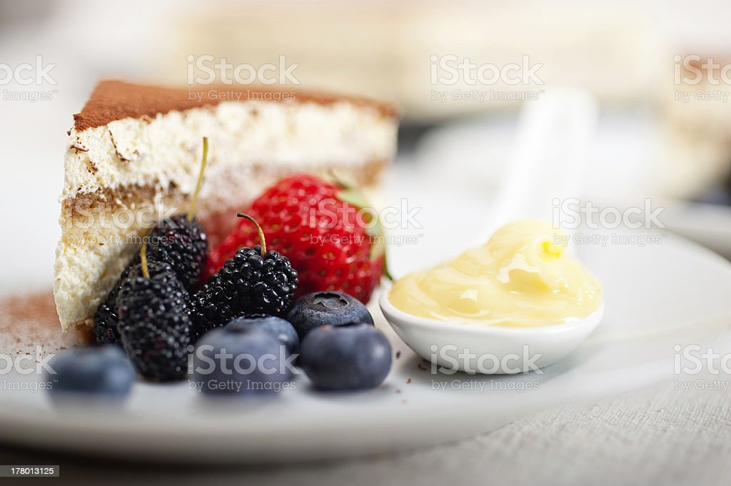 tiramisu dessert with berries and cream stock photo