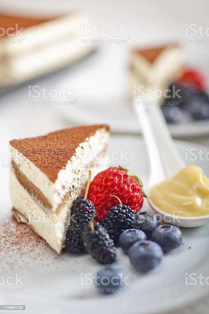 tiramisu dessert with berries and cream royalty-free stock photo