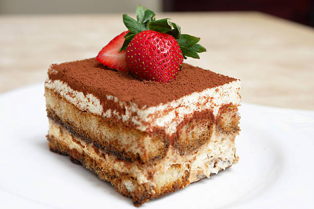 Tiramisu An Italian dessert consisting of layers of sponge cake soaked in coffee and brandy or liquor with powdered chocolate and mascarpone cheese. tiramisu stock pictures, royalty-free photos & images