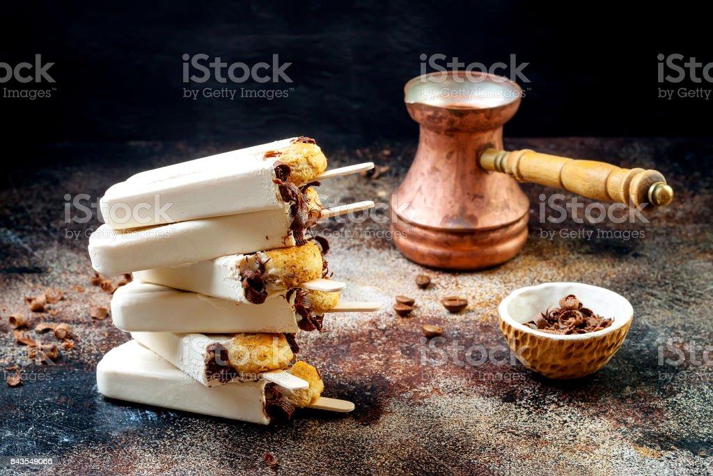 Tiramisu popsicles. Ice pops with italian savoiardi cookies and tiramisu ingredients on rustic kitchen table. stock photo