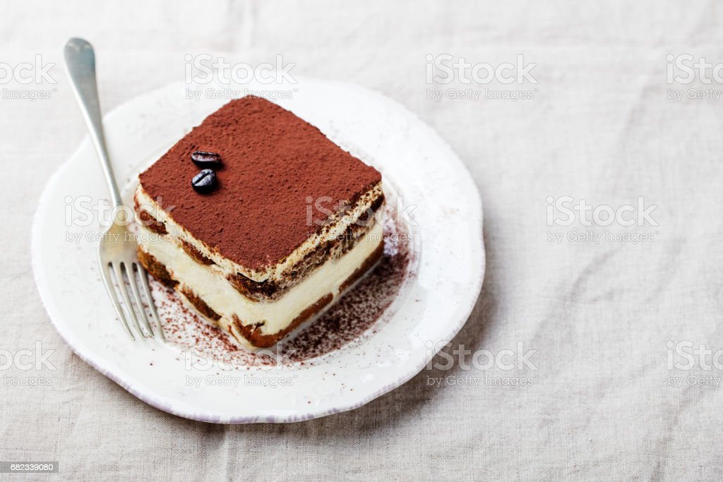 Tiramisu, traditional Italian dessert on a white plate. Copy space. stock photo