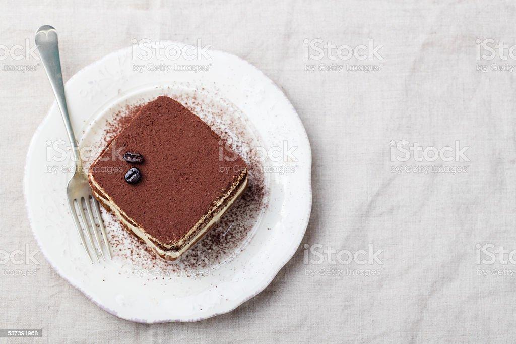 Tiramisu, traditional Italian dessert on a white plate Top view stock photo
