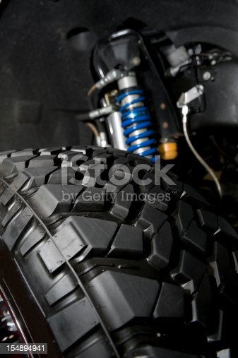 Close up of a small monster truck suspension.