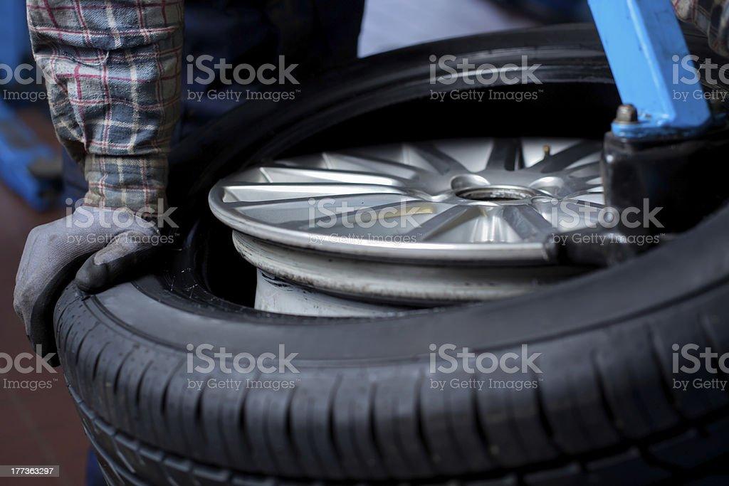 Tire change closeup royalty-free stock photo