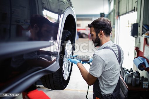 istock Tire changing at car service 846758642