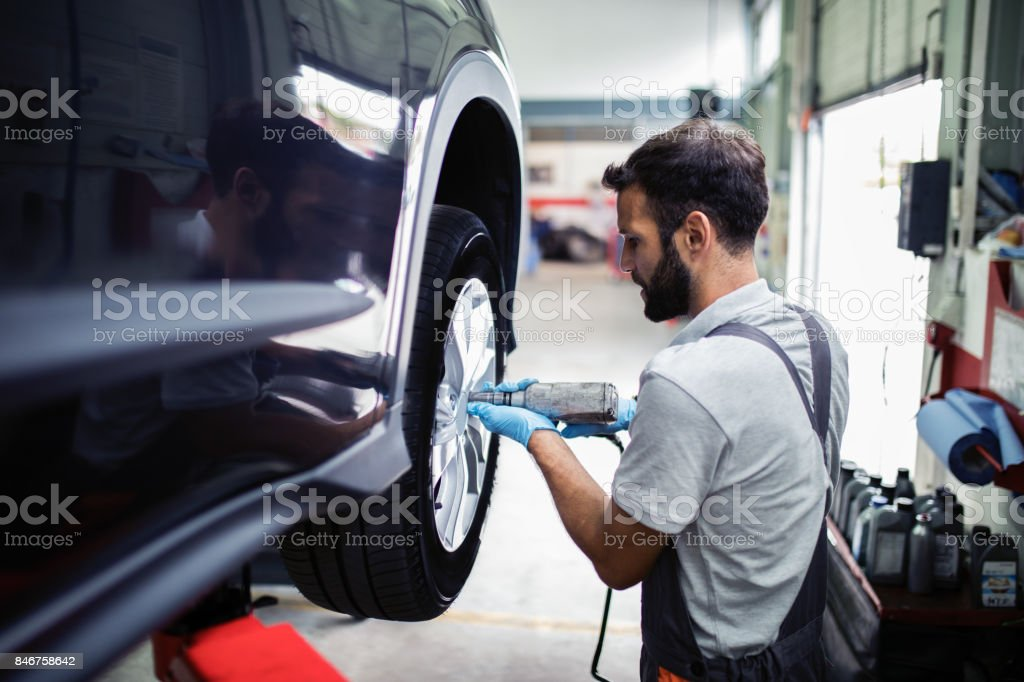 Tire changing at car service stock photo
