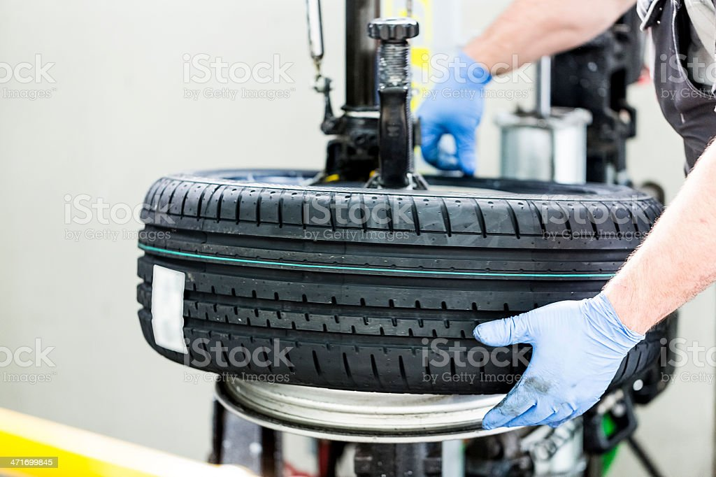 Tire changing royalty-free stock photo