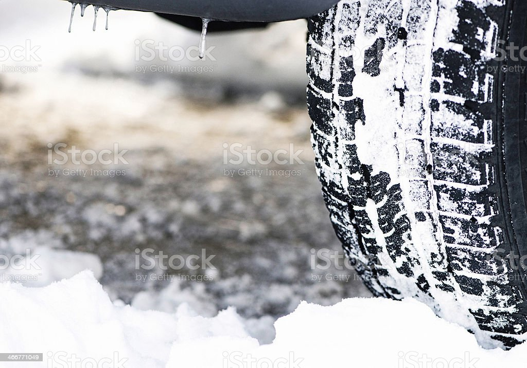 Tire Covered in Snow stock photo