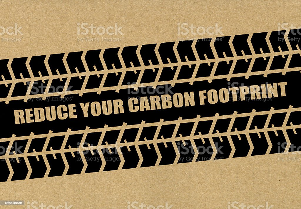 A tire design saying reduce your carbon footprint stock photo