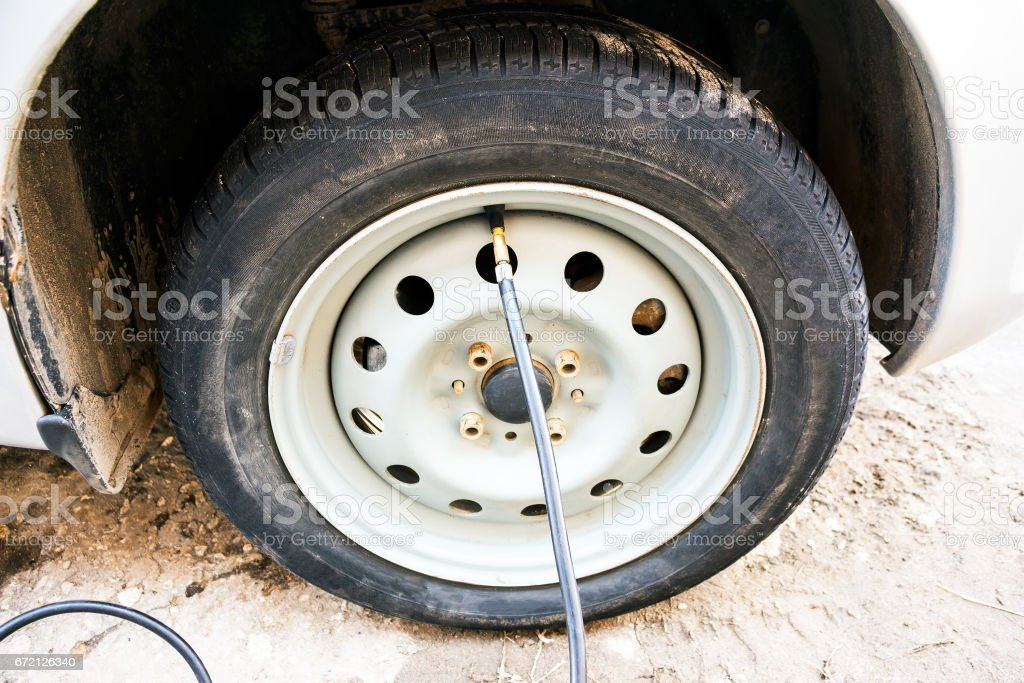 Tire inflation hose Inserted into wheel stock photo