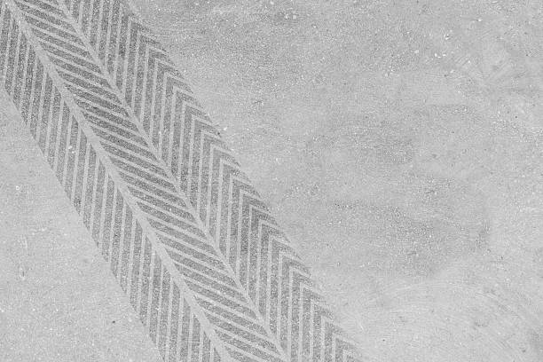 Tire marks on concrete Tire marks on concrete tire track stock pictures, royalty-free photos & images