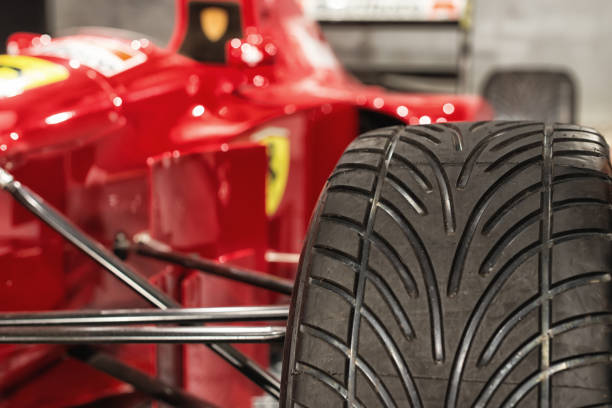 Tire of a ferrari Formula 1 racing car Romanshorn, Switzerland - June 4, 2017: Close up of a rain tire at a Ferrari formula 1 racing car. The picture was taken at a public exhibition in Romanshorn, Switzerland and shows the Ferrari jean alesi drove in the nineties. Ferrari is an Italian sports car manufacturer based in Maranello, Italy. Since it's beginnings, Ferrari has been involved in motorsport. ferrari stock pictures, royalty-free photos & images