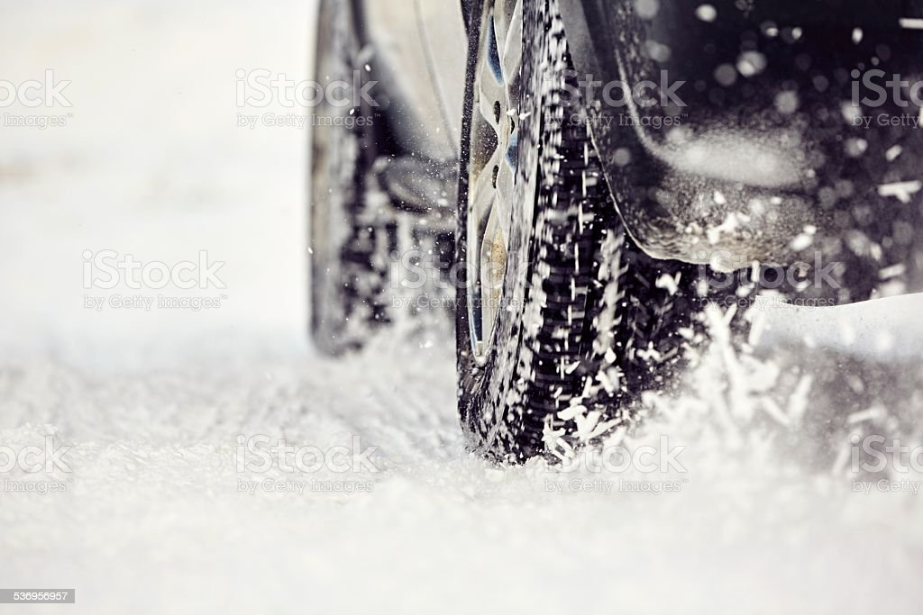 Tire on winter road stock photo
