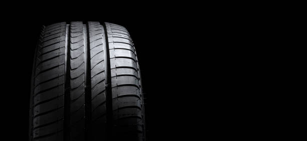 Tire ot tyre profile on black background with copy space stock photo