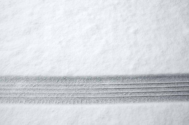 Tire Track in Snow Tire track in fresh snow. tire track stock pictures, royalty-free photos & images