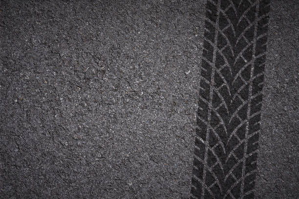 tire track on asphalt tire tread pattern on asphalt background tire track stock pictures, royalty-free photos & images