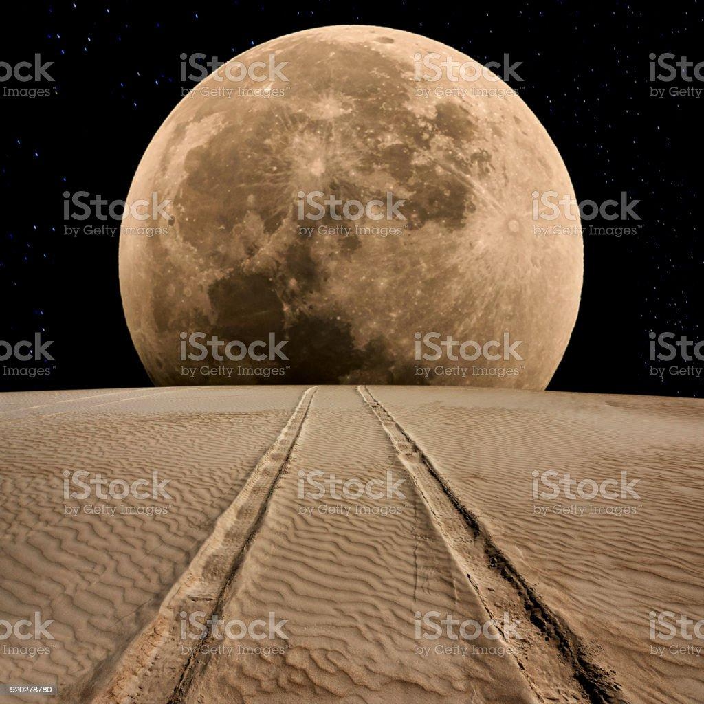 Tire Track on Desert at Supermoon Night stock photo