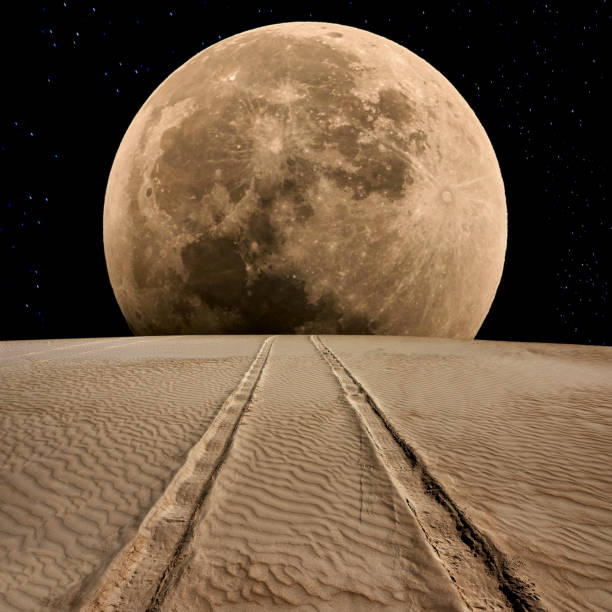 Tire Track on Desert at Supermoon Night Tire track on the desert at supermoon night. tire track stock pictures, royalty-free photos & images