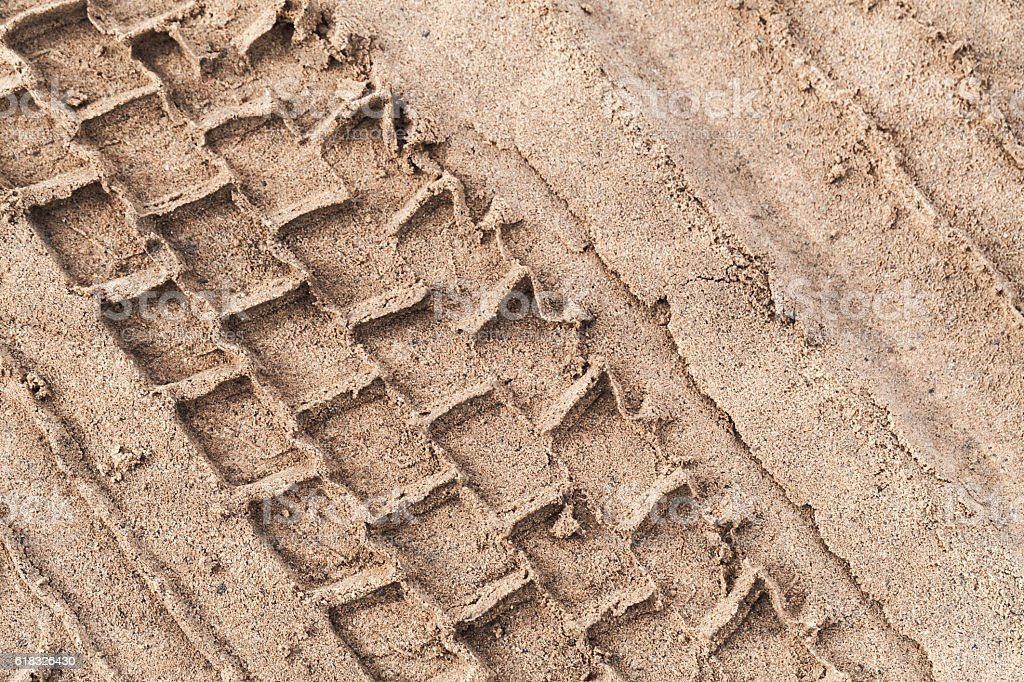 Tire track over wet sand stock photo