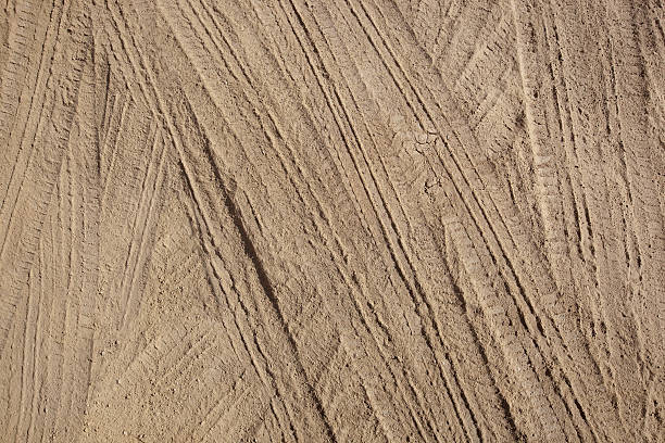 Tire Tracks in Dirt Tire Tracks in Dirt tire track stock pictures, royalty-free photos & images