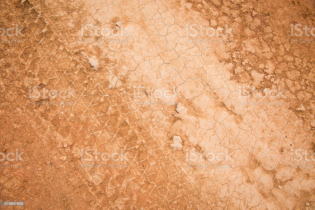 Tire Tracks in Mud Red Clay Dirt Road stock photo