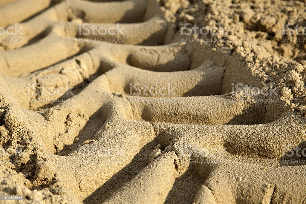 Tire Tracks in the Sand - Close Up royalty-free stock photo