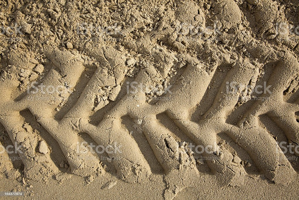 Tire Tracks in the Sand - Frontal Close Up stock photo