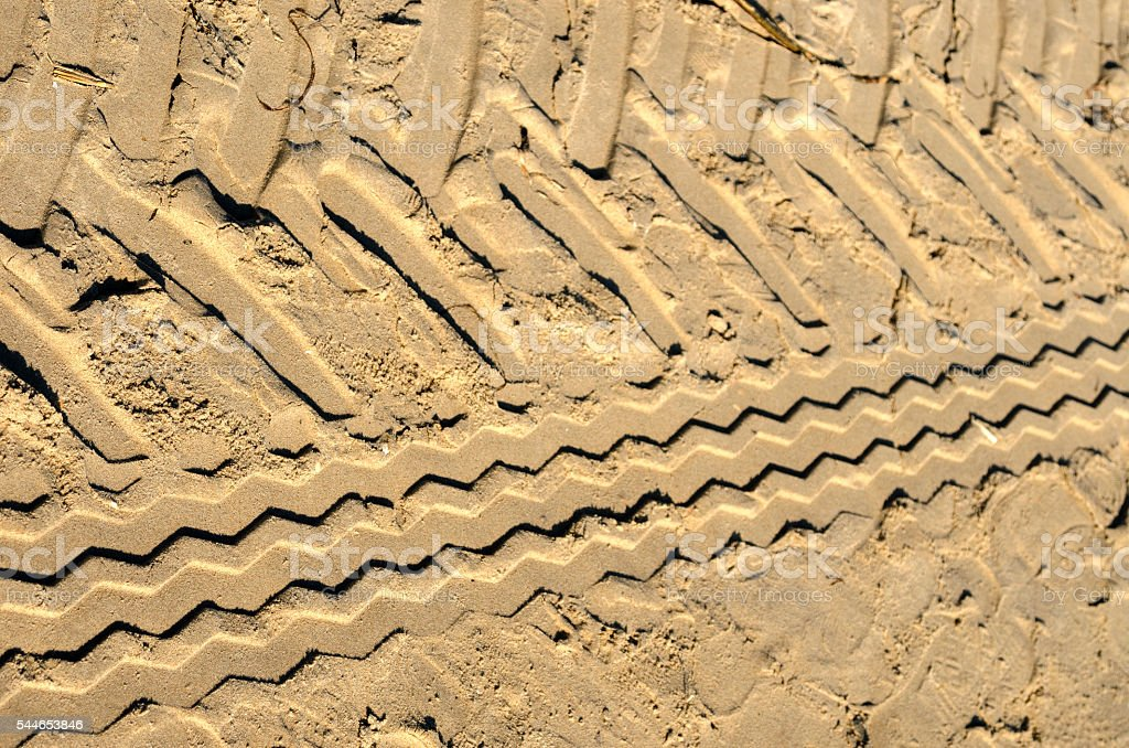 Tire tracks in the sand stock photo