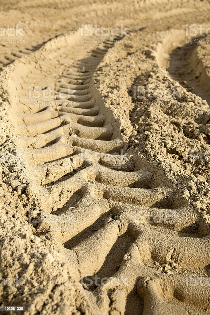 Tire Tracks in the Sand - Surface Level stock photo