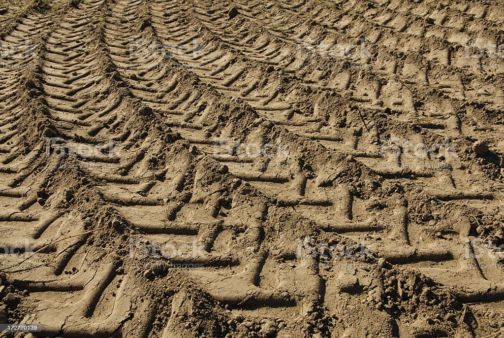 tire tracks on a field, background royalty-free stock photo