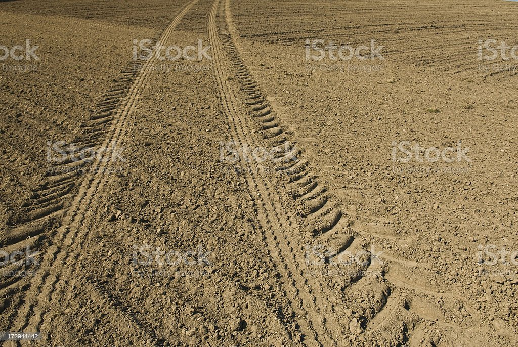 Tire tracks on a field, background stock photo
