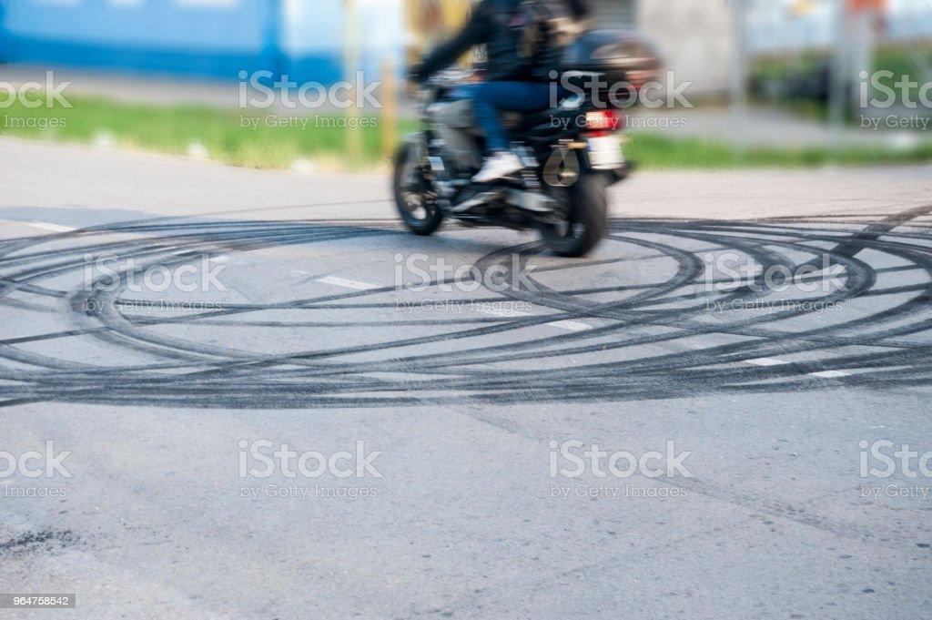 tire tracks on asphalt royalty-free stock photo