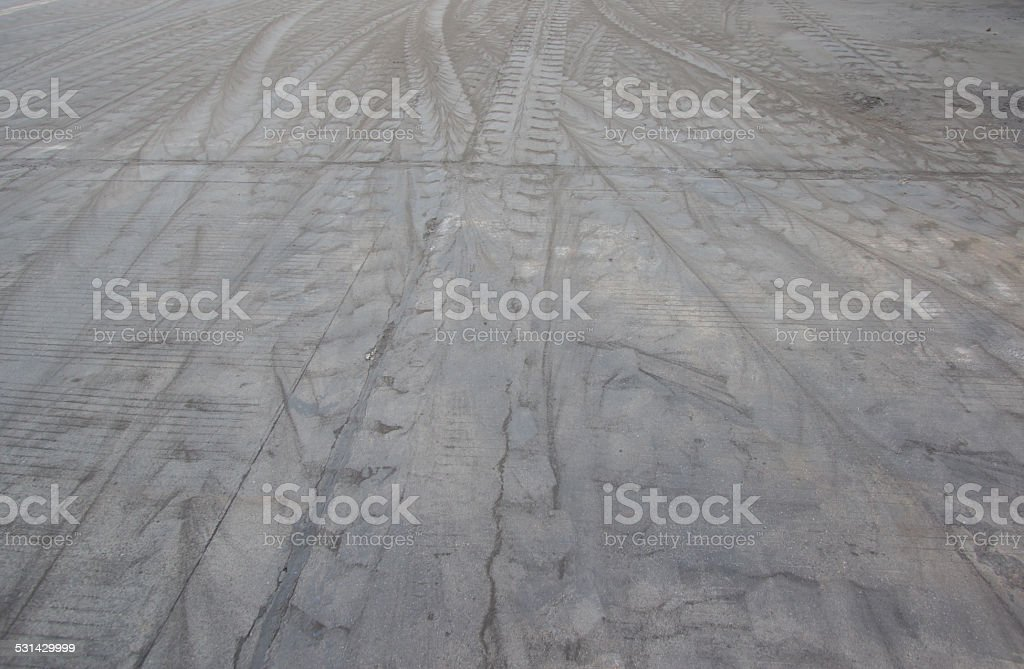 Tire tracks on the cement floor stock photo