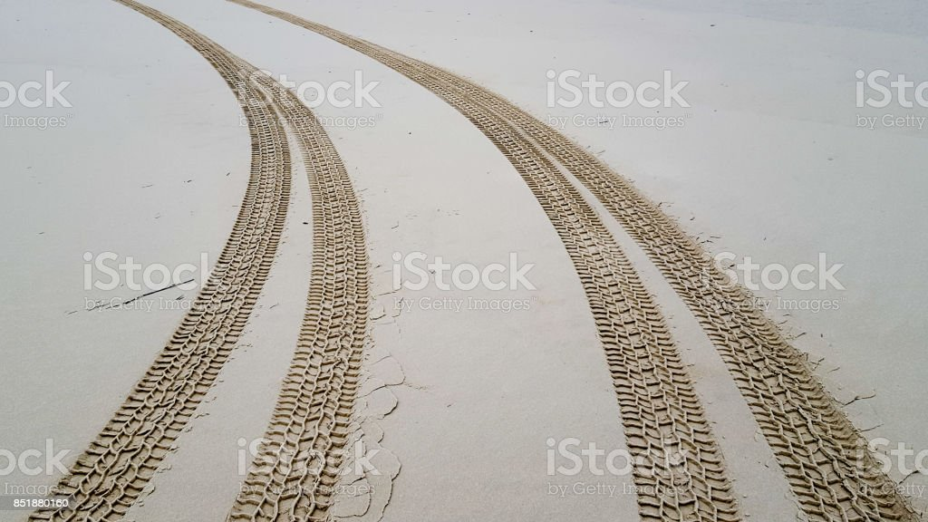 Tire tracks on the sand background stock photo